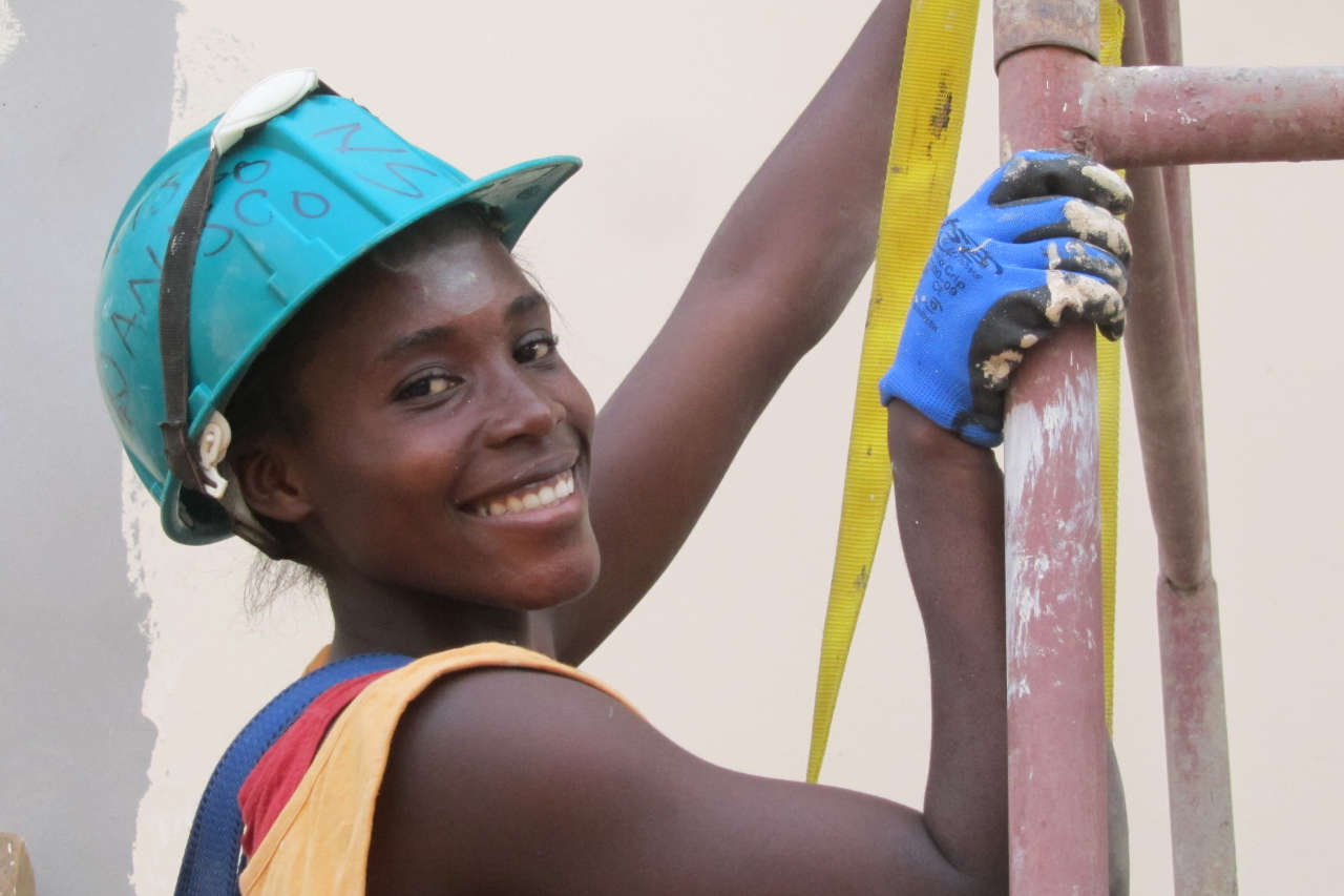 A volunteering painter on the conference centre project in Yaoundé, Cameroon