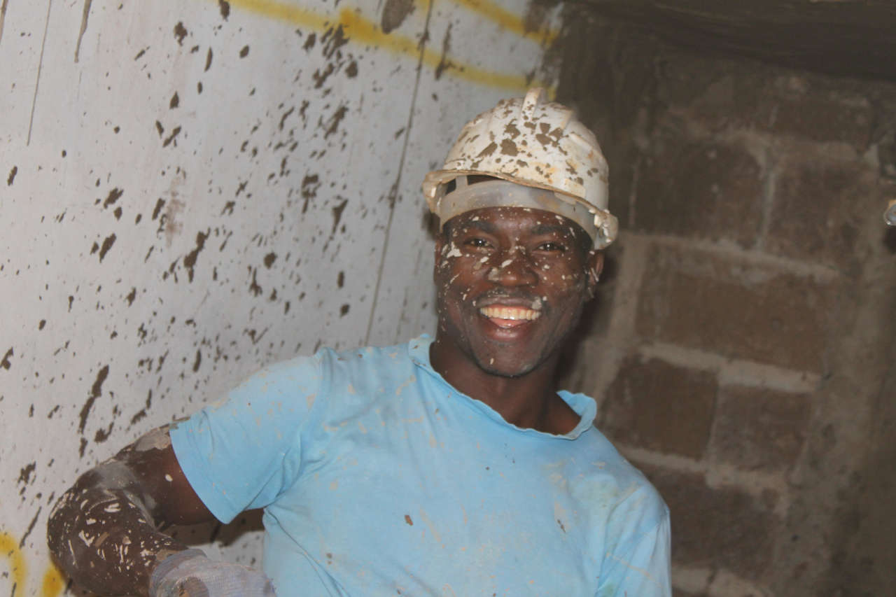 A happy plasterer on the church building project in Lubumbashi, Congo DRC