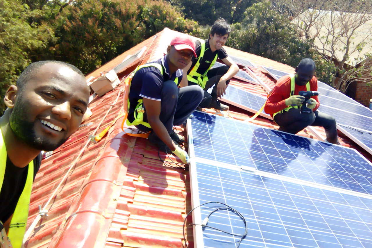 Installing solar panels on the church building project in Lubumbashi, Congo DRC